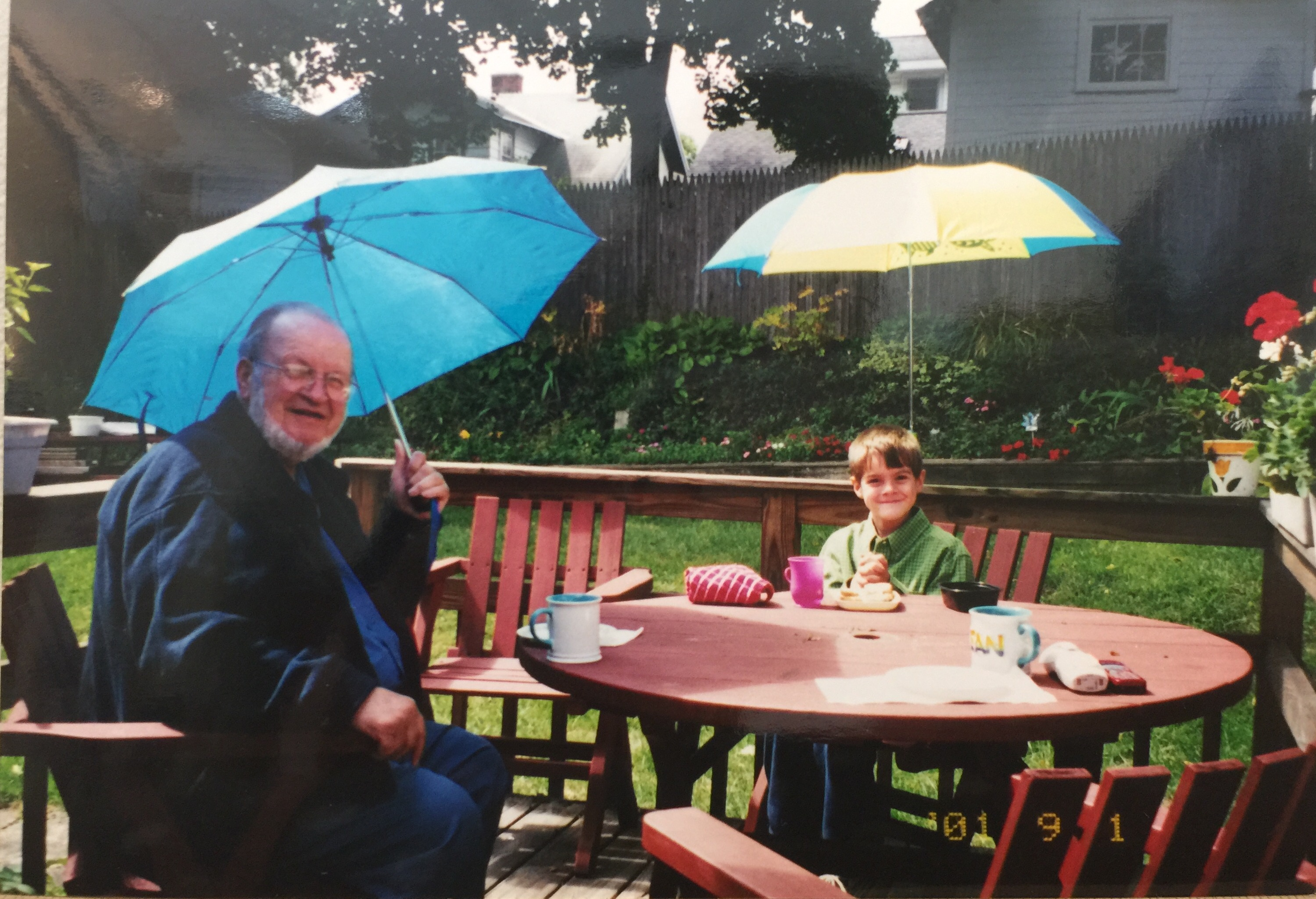 Spending time with Grandpa while enjoying our new umbrellas!